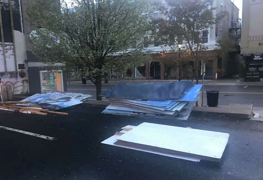 The mural panels were piled in the municipal parking lot next to the Libby building, which is being converted into an apartment house with retail space on the ground floor. Gallery owner John Noelke took the panels Friday and put them in storage. Photo: Delfina Canino McKenna / Contributed Photo