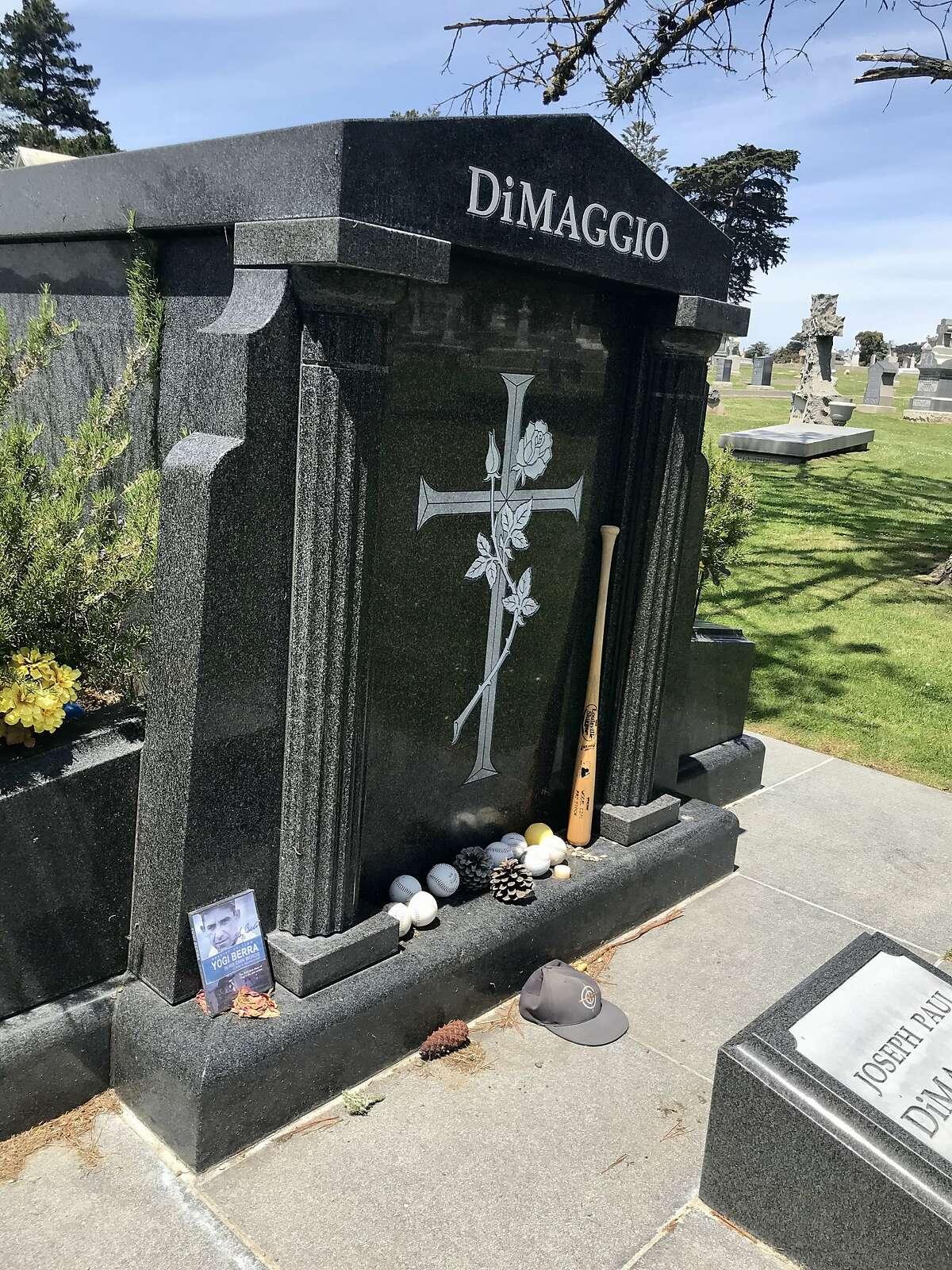 Joe Di Maggio's grave at Holy Cross Catholic cemetery, Colma. Baseball equipment is ready for action, Di Maggio less so.