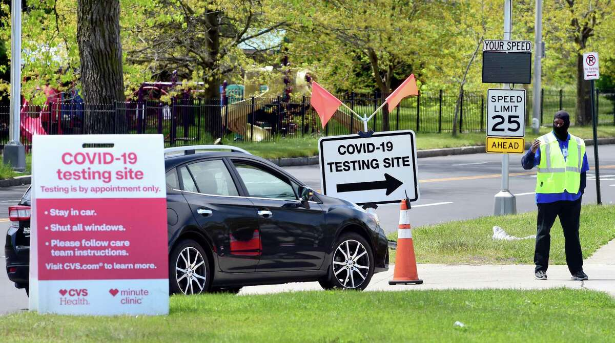 A car enters the rapid result drive-thru CVS Health COVID-19 test site on Sargent Drive in New Haven on May 14, 2020.