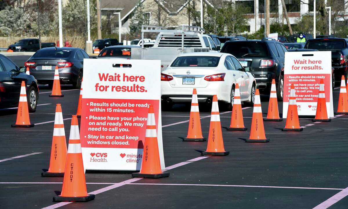 Cars wait in the parking lot of Jordan's Furniture for results after a COVID-19 test by health care providers from CVS MinuteClinics in the parking lot of the former Gateway Community College in New Haven on April 17, 2020 in a partnership between CVS and Abbott Laboratories.