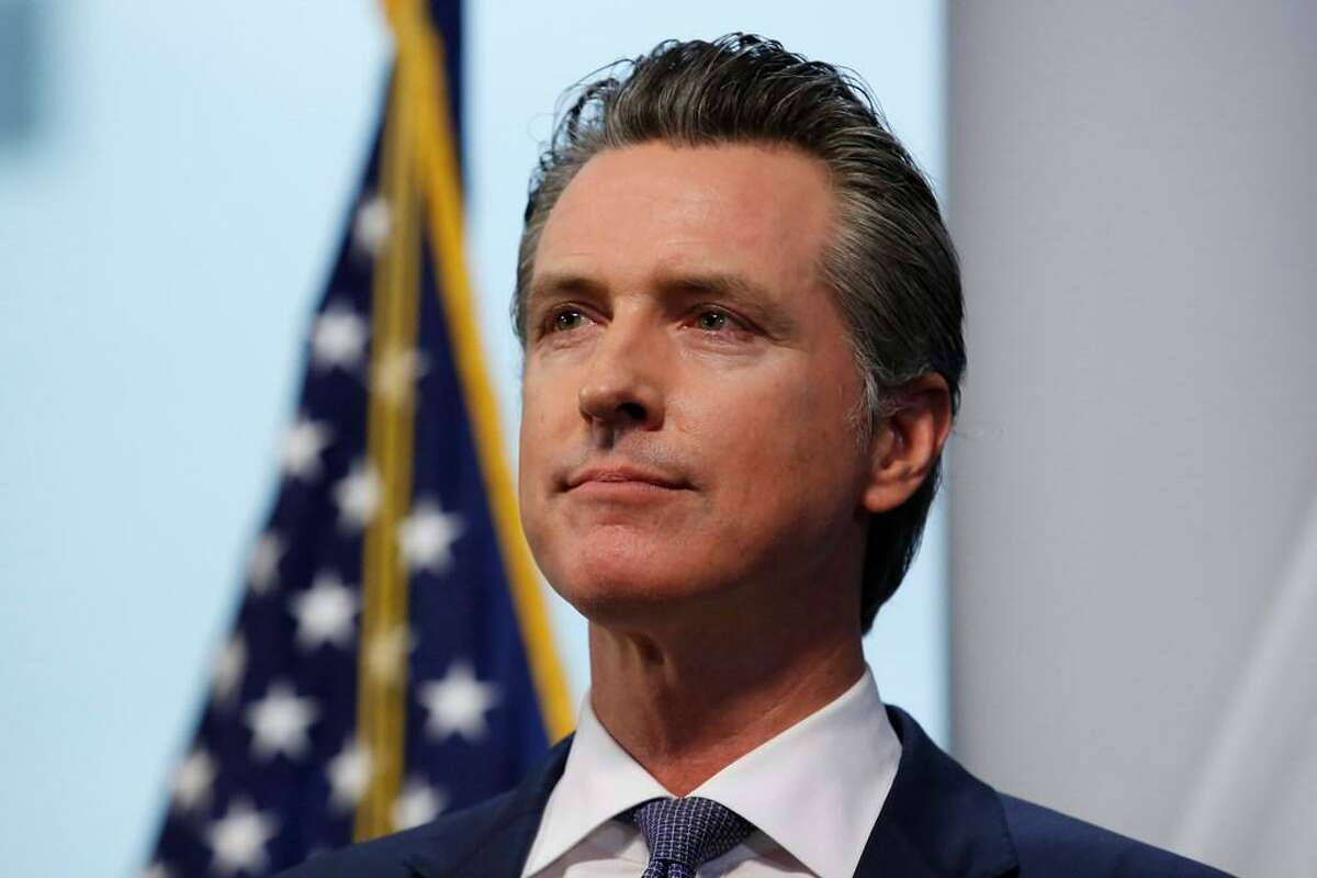 Gov. Gavin Newsom listens to a reporters question during a news conference to update the state's response to the coronavirus at the Governor's Office of Emergency Services in Rancho Cordova, Calif., Monday, March 23, 2020.