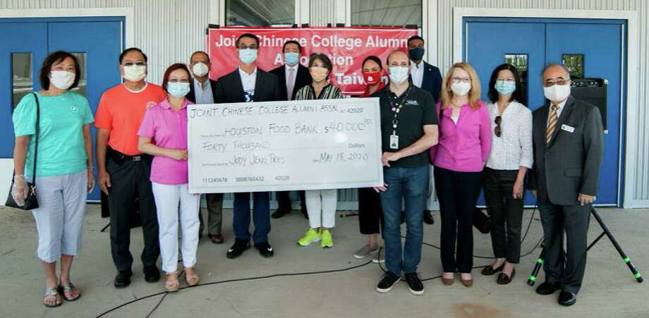 On Monday, May 18, representatives of the Joint Chinese College Alumni Association presented a $40,000 donation to the Houston Food Bank. The donation was made in conjunction with the Southwest Management District to help enable the YMCA, Houston Food Bank and Brighter Bites to distribute 120,000 meals to area needy families. Photo: Courtesy Photo
