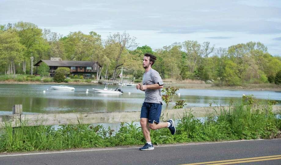 Darien resident Drew Myers ran a half marathon distance in town on Sunday. Photo: Bryan Haeffele / Connecticut Post
