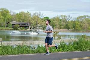 Darien resident Drew Myers ran a half marathon distance in town on Sunday.