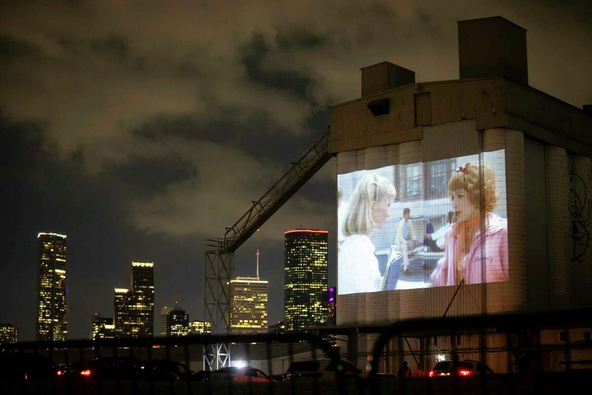 The Houston skyline next to a scene from the movie Grease at the Drive-In at Sawyer Yards on Monday, May 11, 2020.