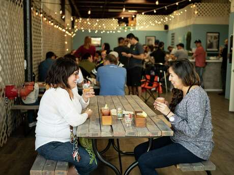 Summer Miloro, left, and Marlene Barrera, right, enjoy their beer flights on the second opening day of Islla St. Brewing Co. in 2019.