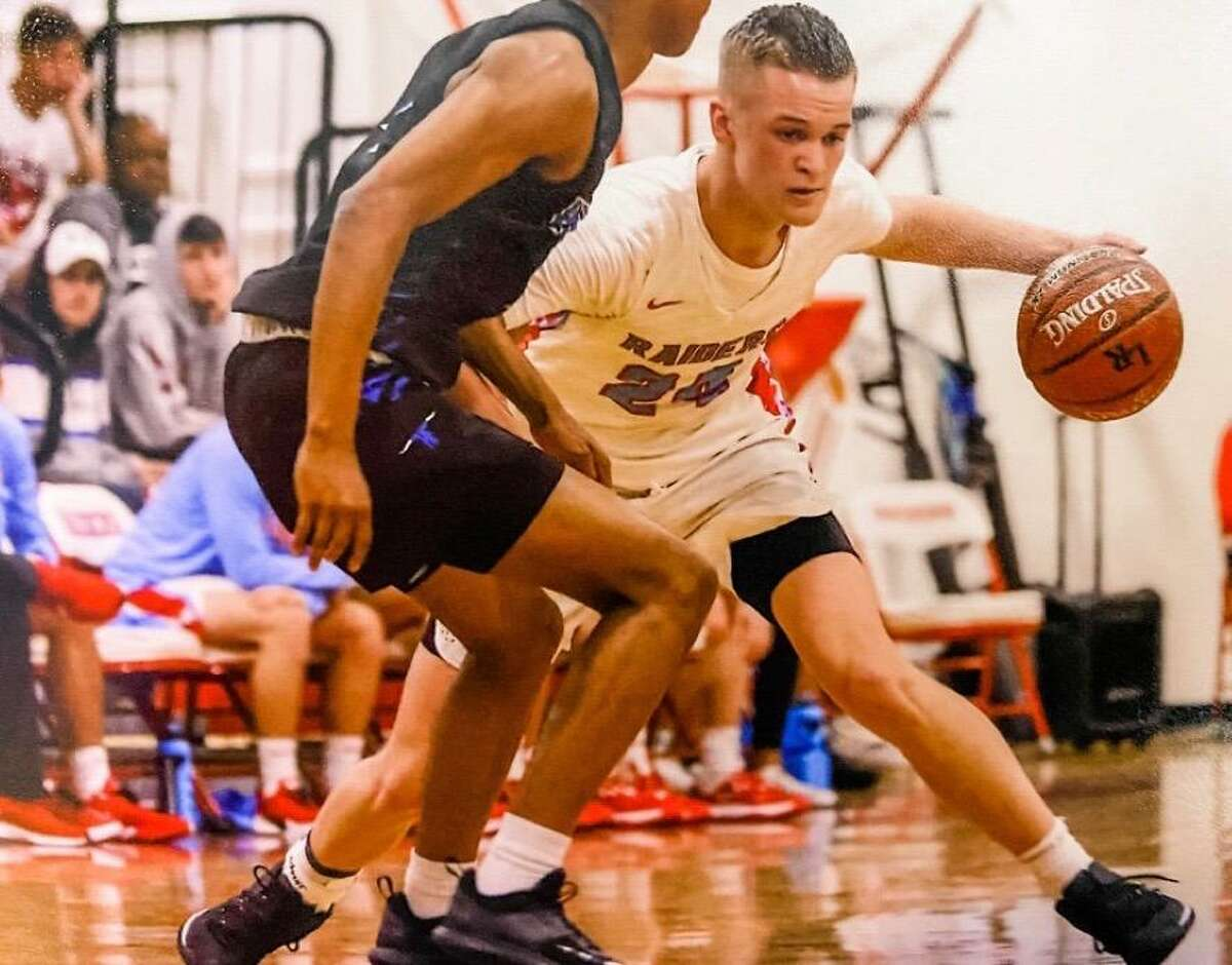 Brock McClure looks to drive around a defender. The 6-foot-6 Lumberton forward has committed to Lamar.