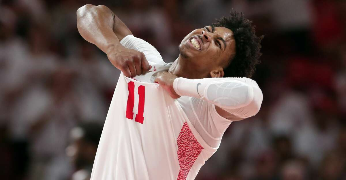 Houston guard Nate Hinton (11) celebrates a score against Cincinnati during the second half of an NCAA college basketball game Sunday, March 1, 2020, in Houston. (AP Photo/Michael Wyke)