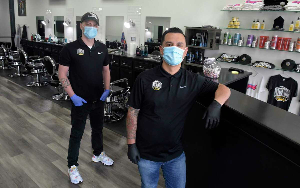 Pat Kelly, left, and Andres Jimenez, co-owners of Legends Barber Co., in their Danbury shop. Friday, April 8, 2020. On Monday, Lamont delayed the reopening of hair salons and barbershops to June 1, just two days before the scheduled restart.