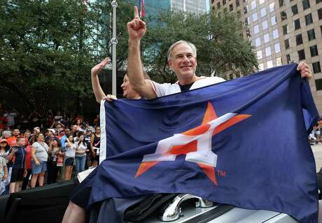 Texas Governor Greg Abbott waves to Astros fans during the team's 2017 championship parade in Houston.
