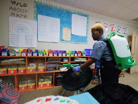 Esther Robinson, unit director for Montgomery ISD's services for education management, uses a cleaning solution combinded with electrostatic technology to disinfect a classroom at Lincoln Elementary School, Thursday, March 12, 2020, in Montgomery. Members of Montgomery ISD's service for education management began additional disinfectant steps at all of the district's 10 schools. Superintendent Beau Rees announced the district would close two days ahead of spring break in an abundance of caution after health officials announced Montgomery County's first 'presumptive positive' case of the coronavirus on March 11.