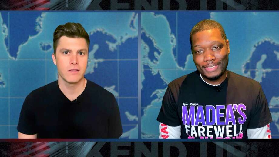 In this screengrab provided by NBC, anchors Colin Jost, left, and Michael Che appear in the Weekend Update during the second at-home episode of a€œSaturday Night Live,a€ which aired Saturday, April 25, 2020. (NBC via AP) / 2020 NBCUniversal Media, LLC