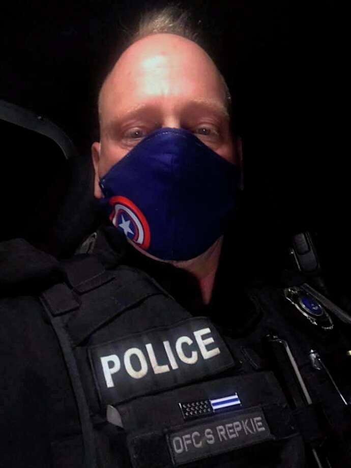 While on duty as a police officer in the three different law enforcement departments he works for, Steve Repkie wears a face mask with a Captian America logo. (Courtesy Photo)