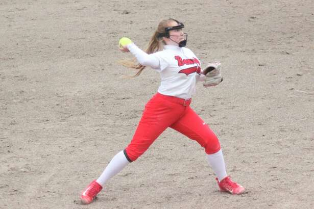 Amie McCall throws to first after charging a grounder at third base in 2019. (File photo)