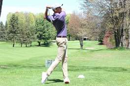 Luke Hammon watches his drive while golfing in the conference championship last spring. (File photo)