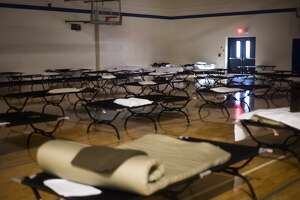 """Cots are available at an emergency shelter at Meridian Junior High for residents of Sanford and Wixom Lakes Tuesday, May 19, 2020 after an evacuation order the night before warning of """"imminent dam failure."""" (Katy Kildee/kkildee@mdn.net)"""