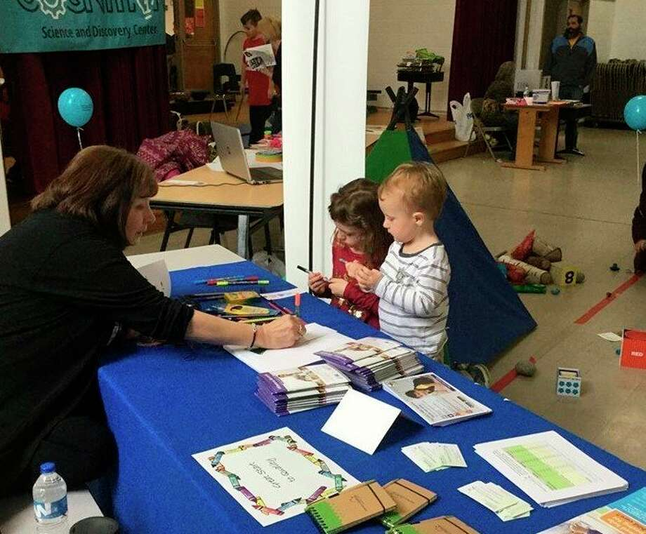 Great Start to Quality NW Resource Center's Terri Bauman, helping families learn about the resources that are available for children in Manistee County. (Courtesy photo)