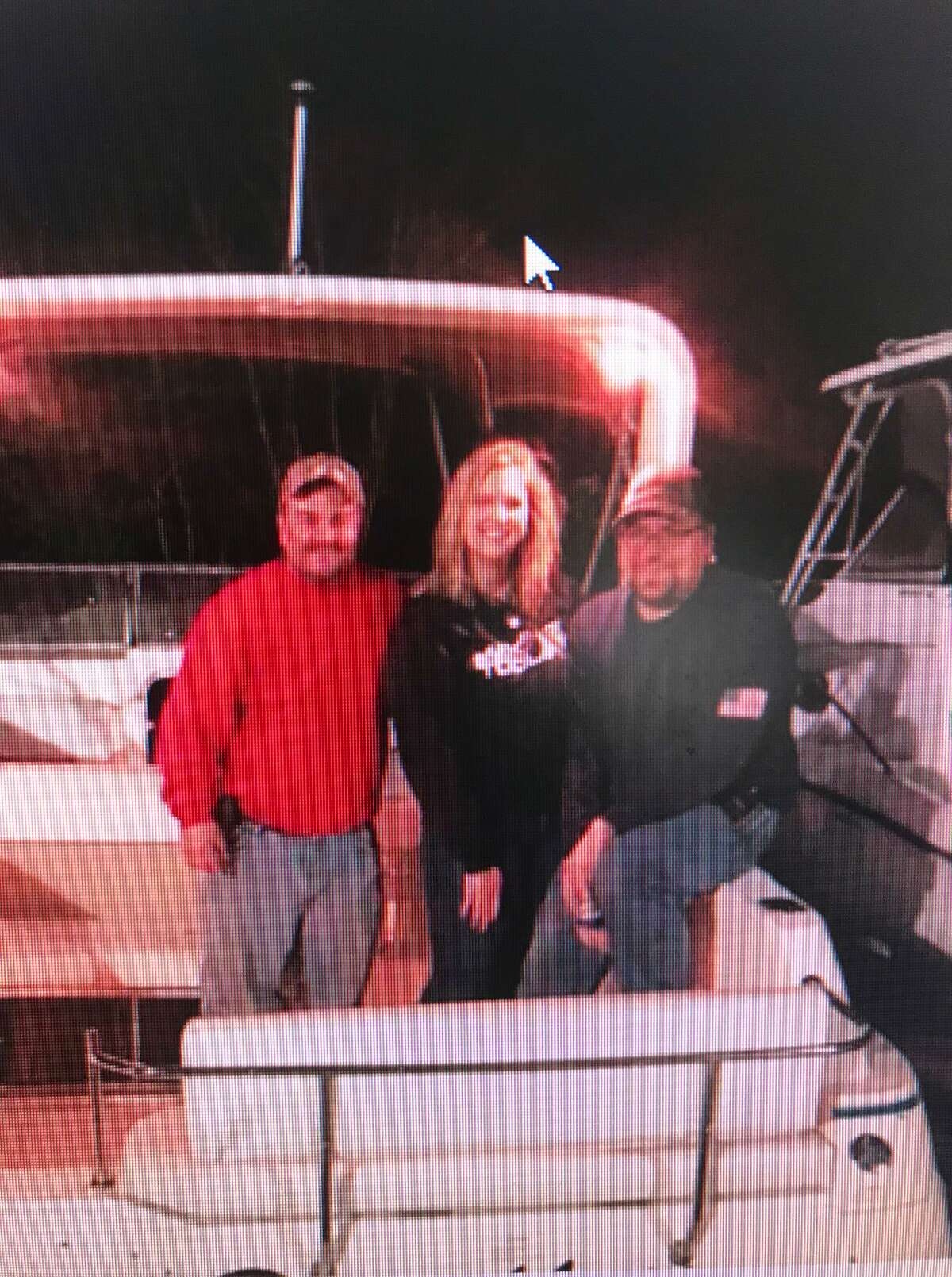 Skipper Joe Hoyt, left, and passengers Morgan Castros and Joey Romaniello saved four kayakers who had been thrown into the water of Wallacks Point early Monday evening in Stamford.