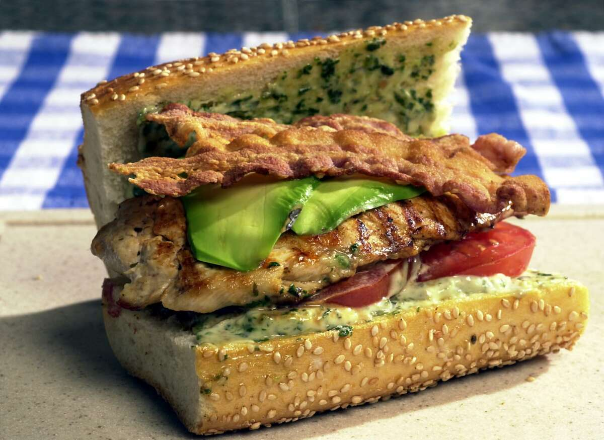 Pounded chicken breast makes a great grilled chicken sandwich with bacon, tomato, avocado and pesto mayo.