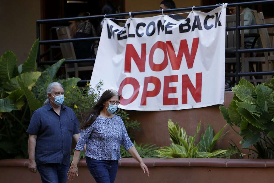 Visitors to the River Walk pass a restaurant that has reopened in San Antonio, Monday, May 18, 2020. Texas Gov. Greg Abbott announced Monday that bars and bowling alleys are on the list of business that can reopen at 25 percent beginning Friday and restaurants can increase to 50 percent capacity as the state continues to go through phases to reopen the state after closing many businesses to battle the spread of the coronavirus. Photo: Eric Gay, Associated Press