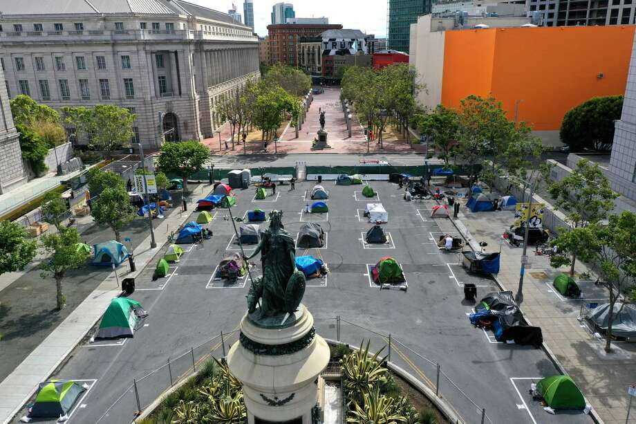FILE: An aerial view of San Francisco's first temporary sanctioned tent encampment for the homeless on May 18, 2020 in San Francisco, California. After public outrage mounted over a surge of homeless people and tents filling the streets of San Francisco during the coronavirus (COVID-19) pandemic, the City opened its first temporary sanctioned tent encampment this week. The camp provides a safe sleeping area in a fenced-off space near City Hall with marked spots for tents that practice social distancing. Toilets, hand washing stations and 24 hours security will also be provided. Other locations throughout the city will be opening soon. (Photo by Justin Sullivan/Getty Images) Photo: Justin Sullivan/Getty Images / 2020 Getty Images