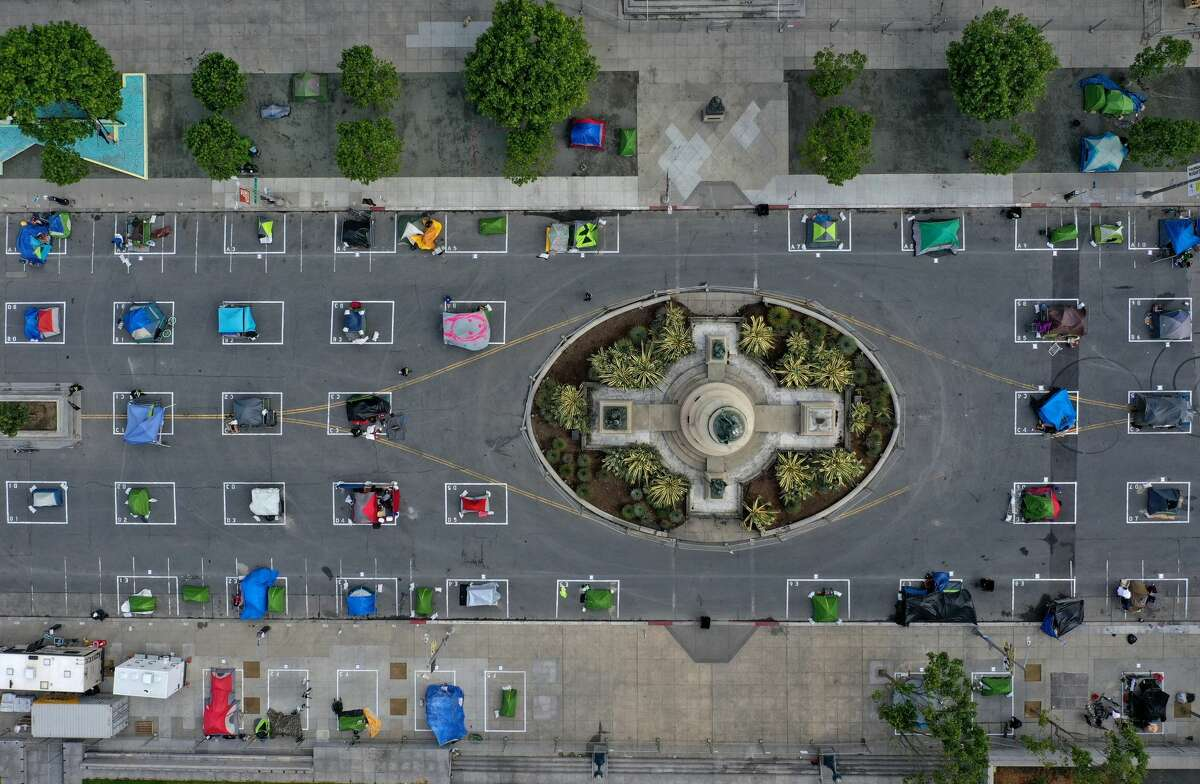 Aerial images captured on May 18 show the camp provides a safe sleeping area in a spacious fenced-off space near City Hall with marked spots for tents that practice social distancing.Occupants must sign a community guidelines agreement and are expected to meet certain expectations around conduct. Only occupants can enter the site through entrances that are monitored by officials 24 hours a day.