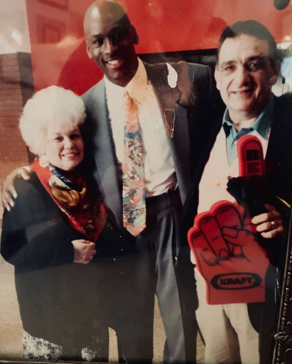Michael Jordan celebrated after a Chicago Bulls game with John and Marlene Elacqua, whom he playfully called