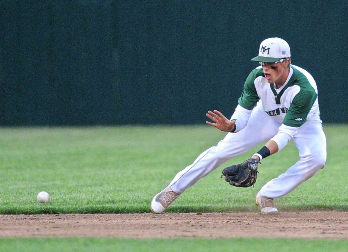 Jackson Olson, a 2016 graduate of New Milford High School, fields a ground ball in the Connecticut high school Class LL boys baseball semifinal game between New Milford and Amity high schools in June 2016. Olson, a graduate of the University of Hartford, hopes to be drafted in the MLB next month.