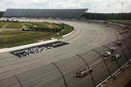 Cars go through a turn at Darlington Raceway during the NASCAR Cup Series auto race Sunday, May 17, 2020, in Darlington, South Carolina. (AP Photo/Jenna Fryer)