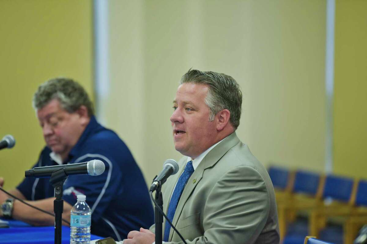 Thomas Brockley, left, with Albany PAL, and Albany County Executive Dan McCoy take part in the daily press conference to discuss corona virus on Tuesday, May 19, 2020, in Albany, N.Y. (Paul Buckowski/Times Union)