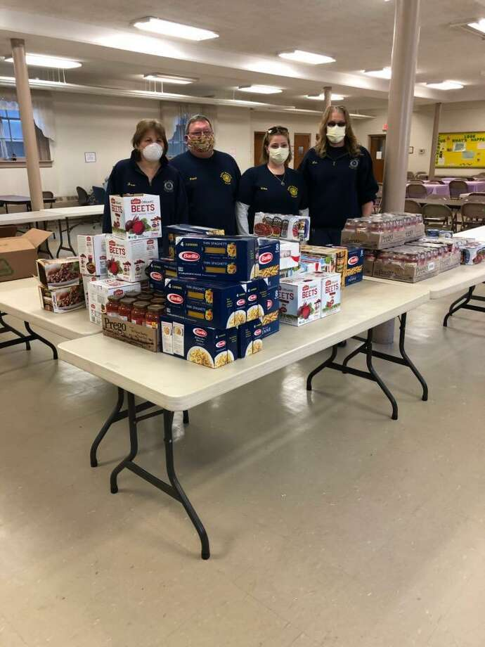 Due to the unprecedented demands as a result of the Covid-19 Pandemic, The East Haven Rotary Club, a member of Rotary District #7980, recently made donation of nearly $1,100 worth of food to the East Haven Food Pantry. The club applied for and received approximately half of the funding from the District's Managed Grants Funding. Recently several Rotarians made the Club's first delivery of the needed items to the Pantry, which operates out of the Christ & The Epiphany Church located next to the East Haven Town Green. The East Haven Rotary Club is now in its 81st year as it was founded in 1939. Since that time, Rotarians from East Haven have been involved in thousands of projects helping the residents of not just East Haven but around the world. In the photo, from left, are Rotary President Joan Adamczyk and Rotarians Paul Adamczyk, Erika Santino Santiago and Liz Esposito. Photo: Contributed Photo