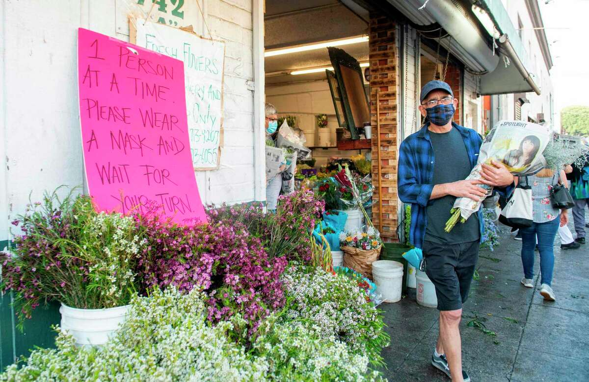 Jasmine Garden flower shops owner Zohrab Mahdessian shops at the flowers Market which just re-opened to be able to fulfill his costumers order for Mothersday, amid the Covid 19 pandemic, May 8, 2020, in Los Angeles, California. - Zohrab Mahdessian opened again his Los Angeles florist shop on May 8, 2020 after five weeks closed for the coronavirus. California authorities decided to relax the lockdown imposed by the pandemic, allowing some businesses to resume operations.And for Mahdessian the timing couldn't be better: On Sunday is Mother's Day in the United States and orders are pouring in. (Photo by VALERIE MACON / AFP) (Photo by VALERIE MACON/AFP via Getty Images)