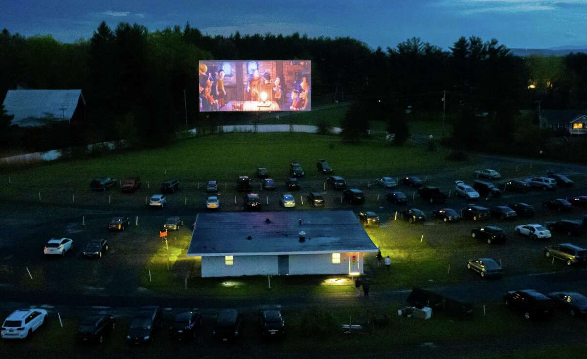 The Jericho Drive-In opened on Friday night, the first chance for moviegoers to get out in months. Other area drive-ins are mulling plans for reopening. Indoor movie theaters remain closed. Some schools are discussing holding graduation ceremonies at drive-ins. ( Jim Franco / Special to the Times Union )