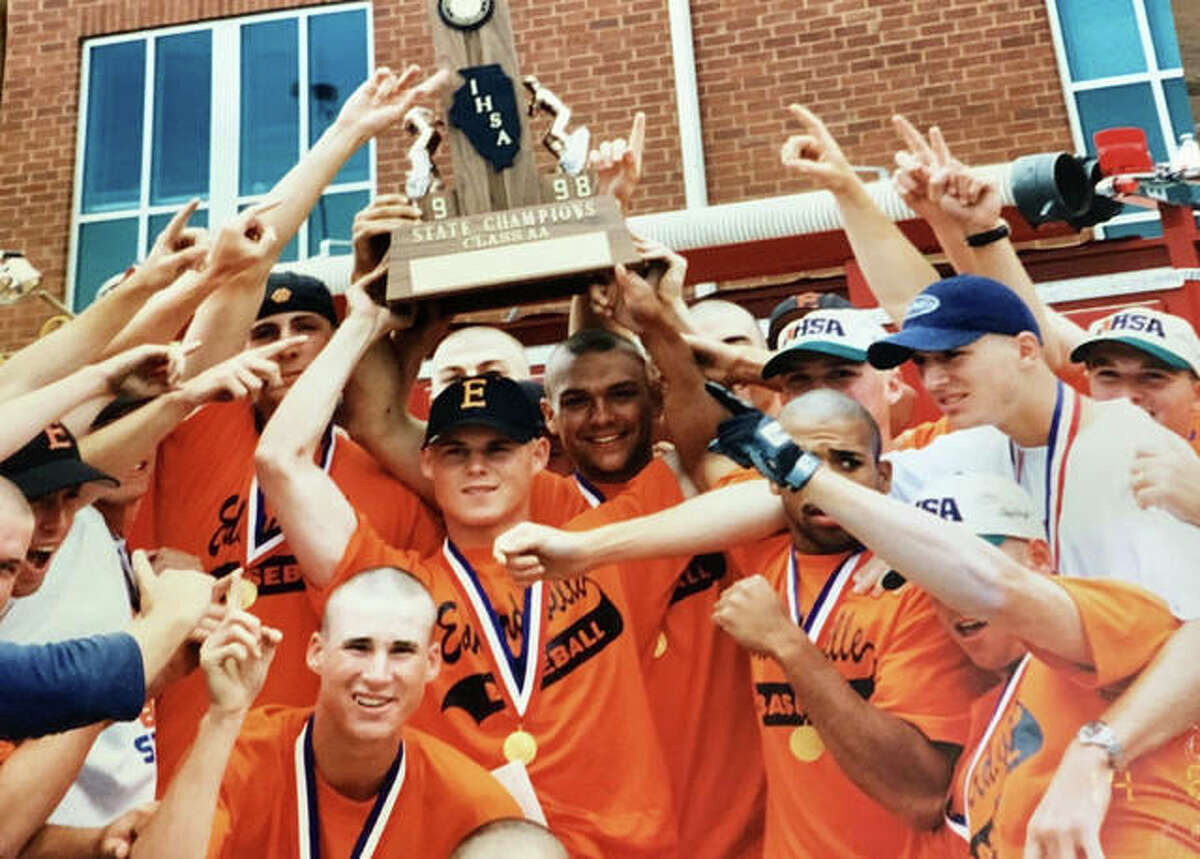 Chad Opel, center, holds the championship trophy after the Edwardsville Tigers won the Class AA state tournament in 1998.