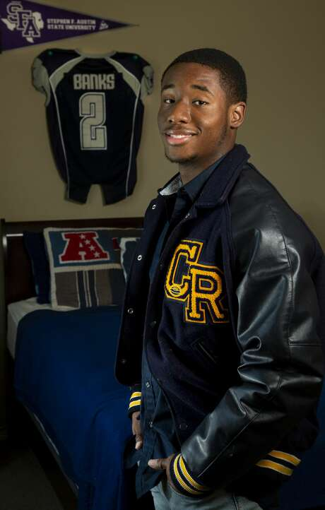 "Cy-Ranch High School student Kobe Banks plans to continue playing football at Stephen F. Austin State University. Of the coronavirus' muddling of end-of-school-year plans, he says, ""you have to cherish the good moments. Because you never know what's going to happen."" Photo: Godofredo A. Vásquez, Staff Photographer / ? 2020 Houston Chronicle"