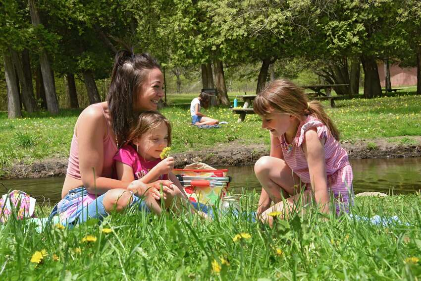 Wednesday will be another day to head outside for some sun, Times Union meteorologist Jason Gough says. In this photograph, Samantha Stivale of Saratoga Springs enjoys the warm weather by having a picnic with her daughters Mia, 5, left, and Lyric, 8, by the stream in Saratoga Spa State Park on Tuesday, May 19, 2020 in Saratoga Springs. Across the stream, Leah Clifford of Saratoga Springs reads. (Lori Van Buren/Times Union)