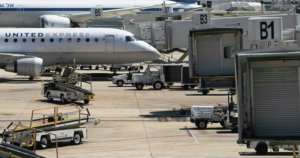 A lone United Express jet parks at a gate at San Antonio International Airport on Monday, May 18, 2020. Traveler numbers at San Antonio International Airport are still a fraction of the amount pre-COVID-19 but the few who are traveling by plane are often essential workers or coming to aid of loved ones. Data shows there has been a slight pickup of passengers as stay at home orders have been lessened.