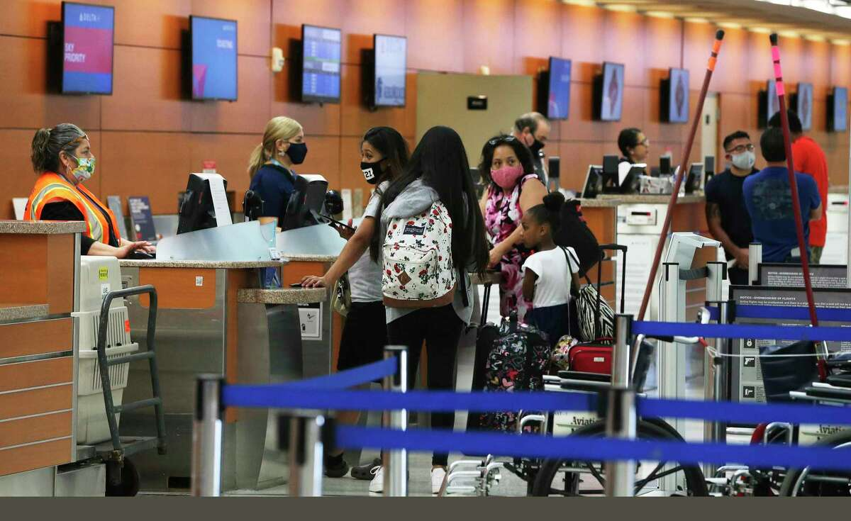 A small amount of travelers check-in at the Delta ticket counter on Monday, May 18, 2020. Travelers at San Antonio International Airport are still a fraction of the numbers pre-COVID-19 but the few who are traveling by plane are often essential workers or coming to aid of loved ones. Data shows there has been a slight pickup of passengers as stay at home orders have been limited.
