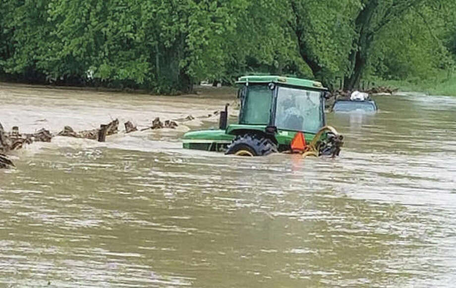 This was the scene encountered when Roodhouse firefighters arrived at Northeast 875th Avenue east of Roodhouse on Saturday when water flooded both a pickup truck and a tractor seeking to reach him. Photo: Photo | Roodhouse Fire Protection District