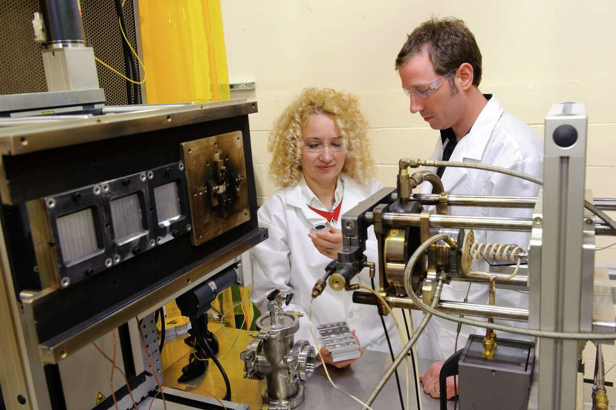 Radenka Maric in her lab with graduate student Justin Roller at the University of Connecticut's Center for Clean Energy Engineering in Mansfield. Research is starting back up at UConn now that the state is beginning to reopen from the pandemic-required shutdown.