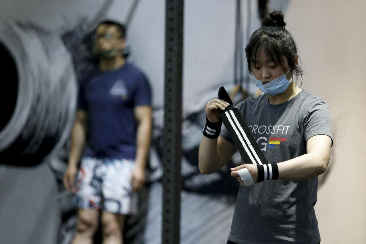 BEIJING, CHINA - MAY 19: A woman wears a protective mask as she trains in a gym on May 19, 2020 in Beijing, China.
