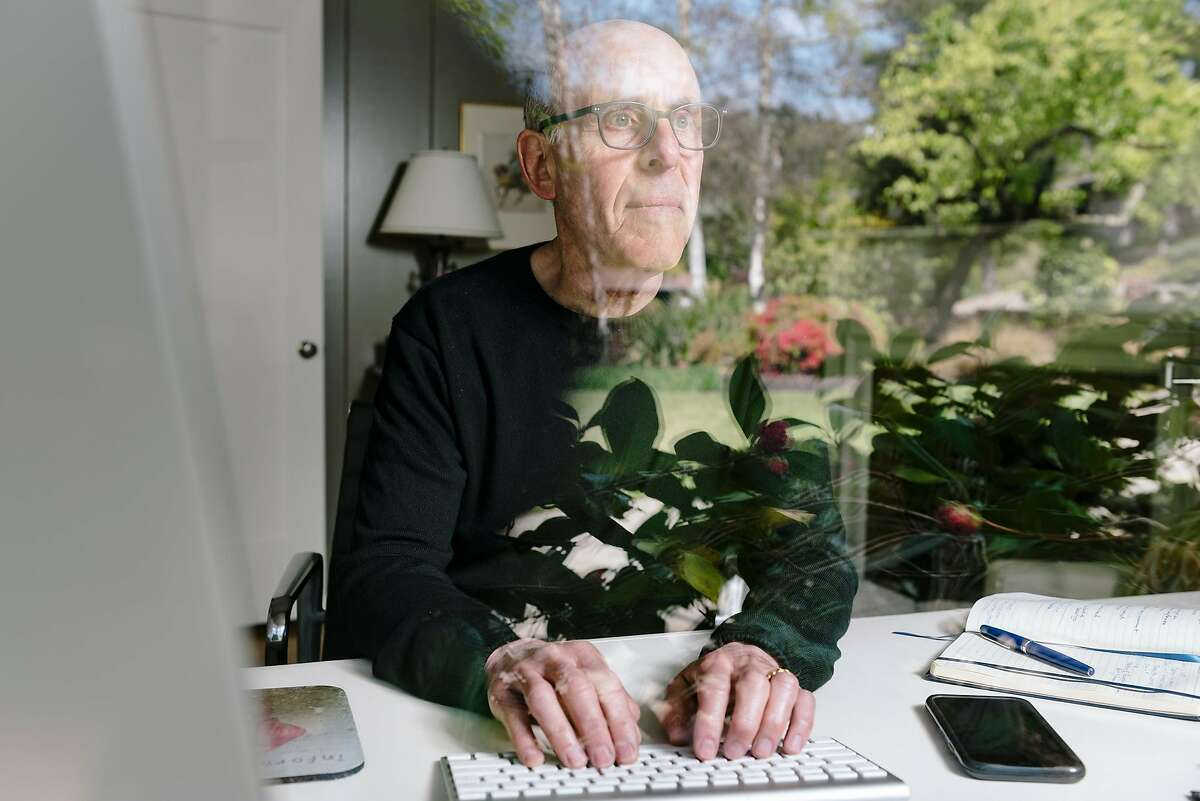 John Swartzberg, an infectious disease expert at the UC Berkeley school of public health, sits for a portrait inside his home office at his home in Lafayette, Calif, on Friday, March 27, 2020.