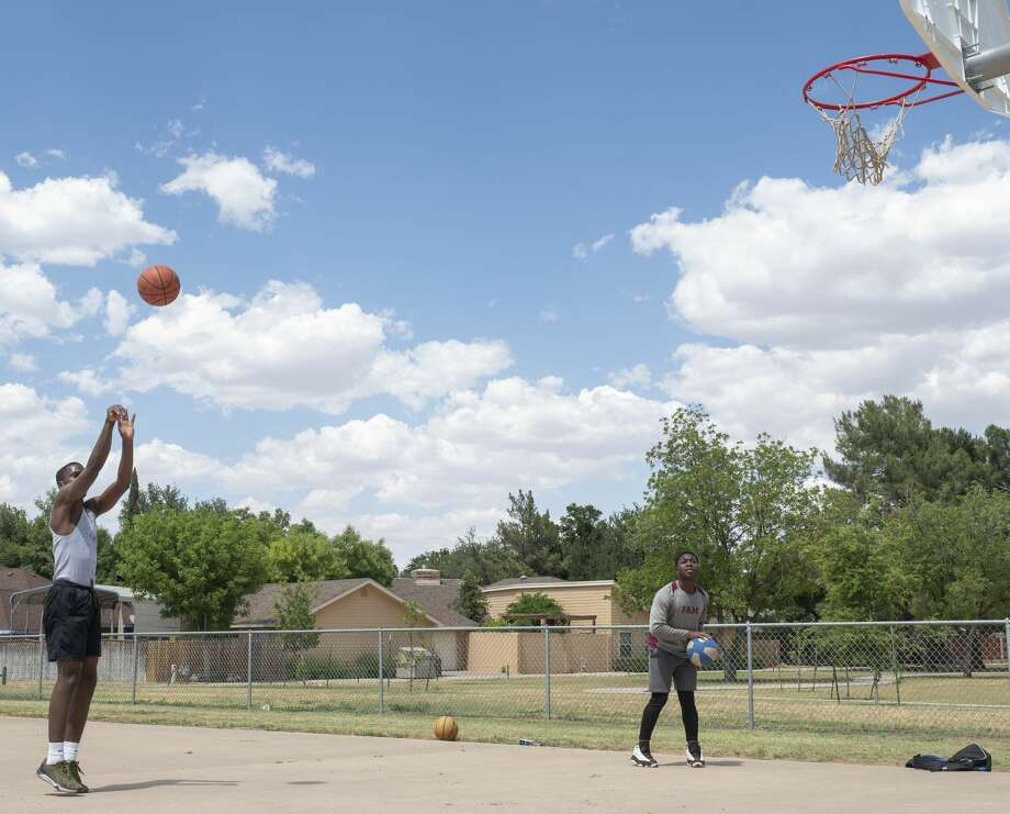 Lee High students Fortunes Efe , shooting, and James Olayiwola play some basketball 05/19/2020 on the courts at Parker Elementary. Tim Fischer/Reporter-Telegram Photo: Tim Fischer/Midland Reporter-Telegram