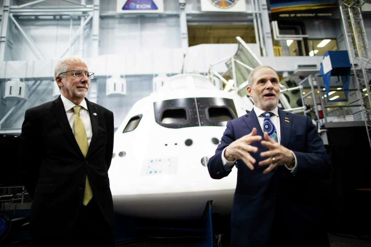 NASA's Johnson Space Center Director Mark Geyer, left, and NASA's Associate Administrator for Human Exploration and Operations Douglas Loverro, right, talk during a press conference at the Johnson Space Center's Space Vehicle Mockup Facility on Monday, Feb. 10, 2020, in Houston. Loverro resigned from his position on Monday, May 18, 2020.