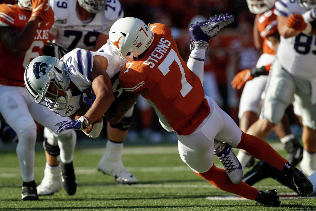 AUSTIN, TX - NOVEMBER 09: Tyler Burns #33 of the Kansas State Wildcats is tackled by Caden Sterns #7 of the Texas Longhorns in the first half at Darrell K Royal-Texas Memorial Stadium on November 9, 2019 in Austin, Texas. (Photo by Tim Warner/Getty Images)