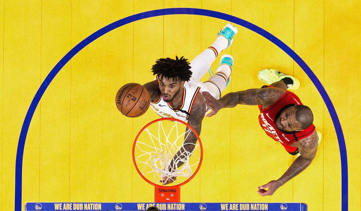 Marquese Chriss (32) goes in for a layup in the first half as the Golden State Warriors played the Houston Rockets at Chase Center in San Francisco, Calif., on Thursday, February 20, 2020.