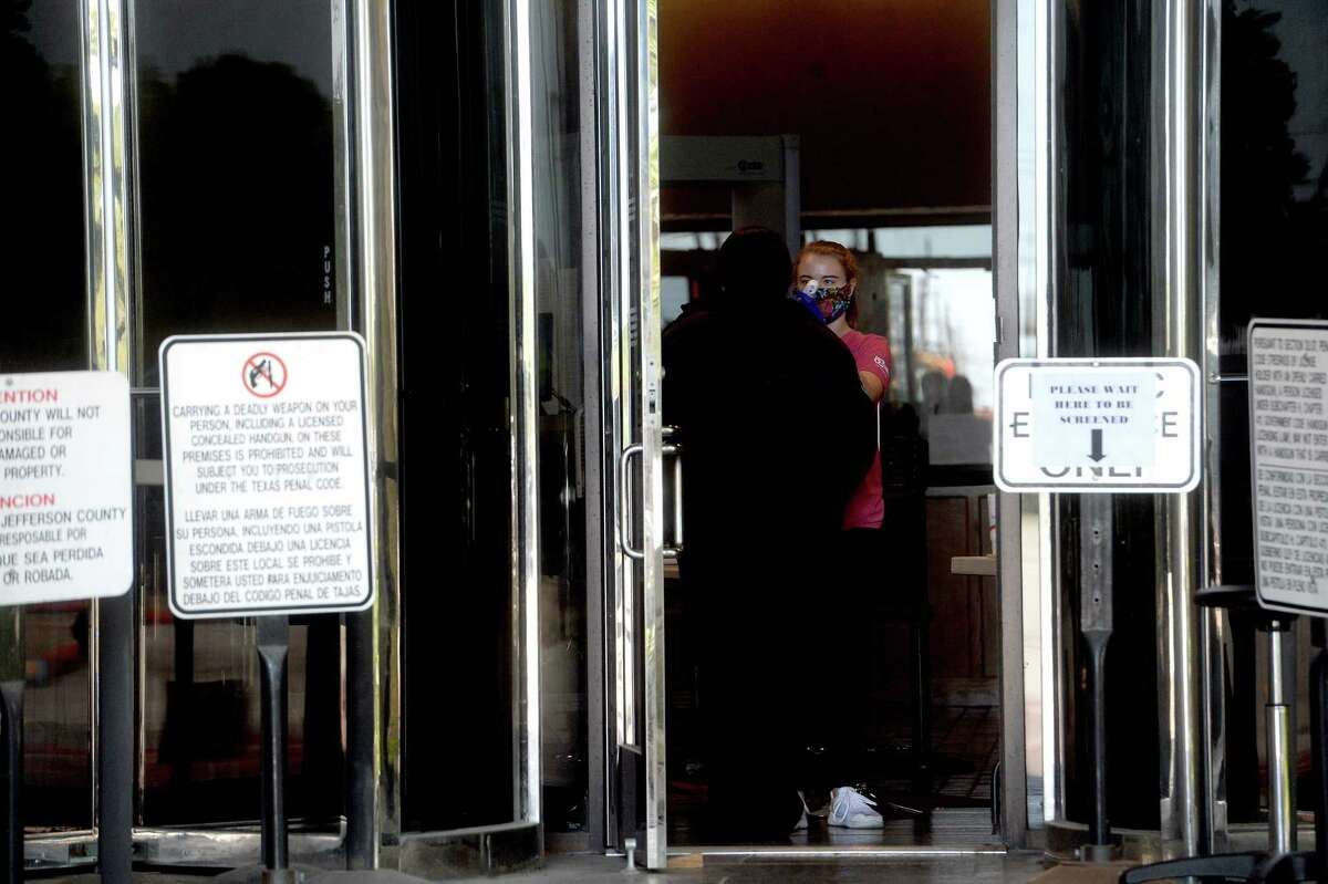 Kara Pent takes temperatures of people entering the Jefferson County Courthouse Tuesday. Anyone entering the facility must be screened for any indication of favor in order to proceed. Photo taken Tuesday, May 19, 2020 Kim Brent/The Enterprise