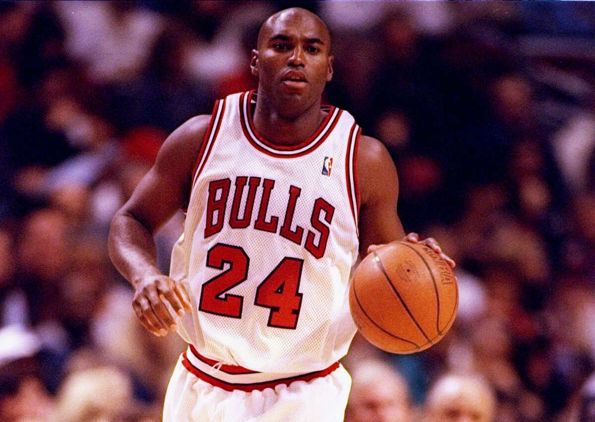 9 Oct 1997: Forward Scott Burrell of the Chicago Bulls drives the ball down the court during a preseason game against the Atlanta Hawks at the United Center in Chicago, Illinois. The Hawks won the game 84-83.