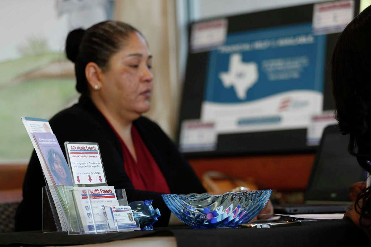 ACA Health Experts call center expert, Cynthia Hernandez helps Tiffany Wright get health insurance at the Ahmed and Roshan Virani Children's Clinic, Monday,Nov. 14, 2016 in Houston. It's likely that 2021 health insurance premiums will remain around the same prices as 2020, experts said.
