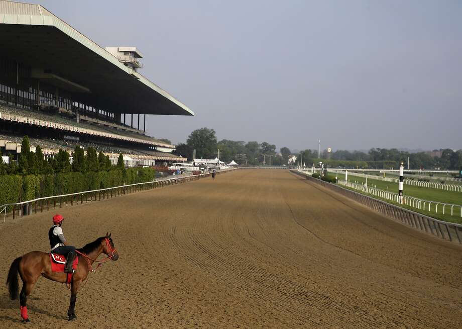 FILE - In this June 8, 2019, file photo, a rider looks out over a mostly empty track during workouts at Belmont Park in Elmont, N.Y. The Belmont Stakes will be run June 20, 2020, without fans and serve as the opening leg of horse racing's Triple Crown for the first time in the sport's history. The New York Racing Association on Tuesday, May 19, 2020, unveiled the rescheduled date for the Belmont, which will also be contested at a shorter distance than usual. This is the first time the Belmont will lead off the Triple Crown ahead of the Kentucky Derby and Preakness. (AP Photo/Seth Wenig, File) Photo: Seth Wenig / Associated Press